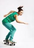 Meisje met skateboard Stock Afbeelding