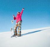 Meisje met snowboard op de sneeuw Stock Fotografie