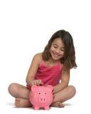 Meisje met spaarvarken Stock Foto's