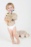 Meisje met speelgoed Stock Afbeelding
