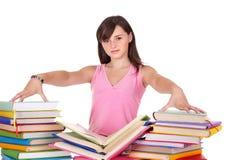 Meisje met stapel gekleurd boek. royalty-vrije stock afbeeldingen