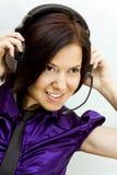 Meisje met telefoonhoofden Stock Foto