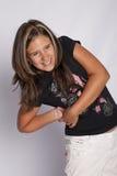 Meisje met terug pijn in haar Stock Foto