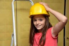 Meisje met veiligheidshelm stock afbeelding