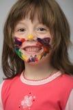 Meisje met verf op gezicht stock fotografie