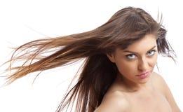 Meisje met wind in haar stock afbeelding