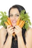 Meisje met wortelen Stock Afbeeldingen