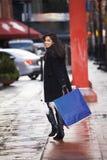 Meisje met zakken Stock Foto
