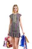 Meisje met zakken na het winkelen Stock Afbeeldingen