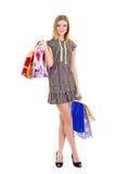 Meisje met zakken na het winkelen het glimlachen Stock Fotografie