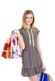 Meisje met zakken na het winkelen portret Stock Afbeeldingen
