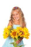 Meisje met zonnebloemen Stock Foto
