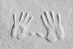 De Druk van de hand in de Sneeuw Stock Afbeeldingen