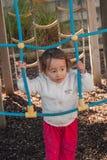 Meisje op de speelplaats Stock Foto's