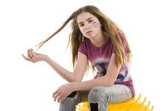 Meisje op een bal Stock Foto's