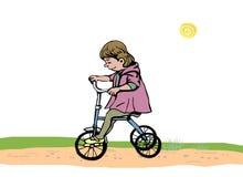Meisje op een driewieler Stock Afbeelding