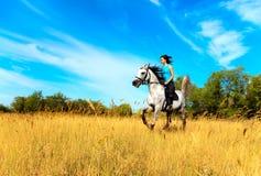 Meisje op een paard Royalty-vrije Stock Foto's