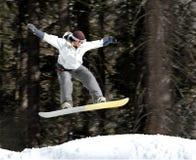Meisje op een snowboard stock foto
