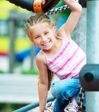 Meisje op een speelplaats Stock Foto's