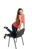 Meisje op een stoel Stock Foto