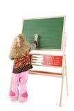 Meisje op een zwarte raad stock afbeelding