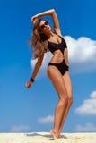 Meisje op het zand Stock Foto