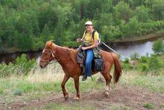 Meisje op horseback Stock Fotografie
