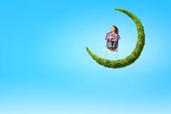 Meisje op maan Stock Afbeeldingen