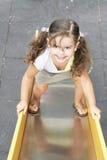 Meisje op schuif Stock Foto's