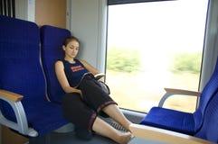 Meisje op trein #7 stock afbeeldingen
