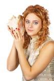 Meisje op wit met shell Stock Afbeeldingen