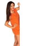 Meisje in Oranje kleding stock afbeelding