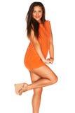 Meisje in Oranje kleding royalty-vrije stock afbeelding