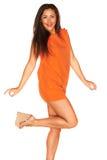 Meisje in Oranje kleding royalty-vrije stock afbeeldingen