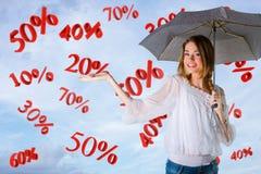 Meisje over een hemelachtergrond, percents vallend Stock Fotografie