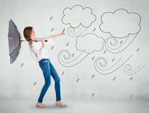 Meisje over een witte muur, slecht weerconcept Stock Foto's