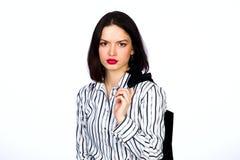 Meisje in overhemd en vest op een witte achtergrond Royalty-vrije Stock Fotografie