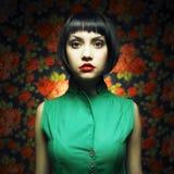 Meisje-pop in groene kleding Royalty-vrije Stock Afbeelding