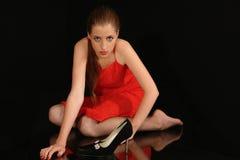 Meisje in rode doek Stock Foto