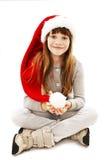 Meisje in rode Kerstmanhoed royalty-vrije stock afbeeldingen