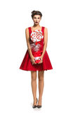 Meisje in rode kleding met groot suikergoed royalty-vrije stock foto's