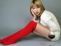 Meisje in rode kousen en een wit jasje Stock Afbeelding