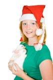 Meisje in santahoed met konijnen stock foto