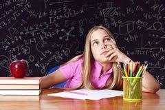 Meisje in school stock foto
