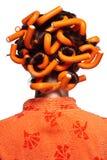 Meisje in sinaasappel Stock Afbeelding