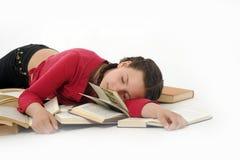 Meisje in slaap op boeken Stock Afbeeldingen