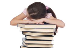 Meisje in slaap op boeken Royalty-vrije Stock Afbeeldingen