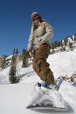 meisje snowboarder met vertrouwen royalty-vrije stock foto's
