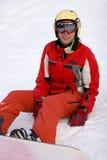 Meisje snowborder na weerslag stock foto