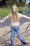 Meisje in speelplaats Stock Foto